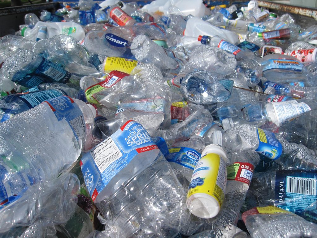 plastic bottles polluting the surface of the land
